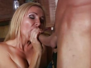 MILF Lisa Lee sucks and tit fucks cock in advance of a fuck