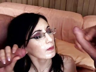 Raunchy Nora Davis gets her glasses splattered with cum