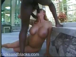 Busty redhead Sana Fey sucks and gets ass fucked by black cock