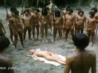 Naked Golden-haired Monica Zanchi Captured by Cannibals