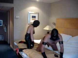 Strapon mistress fucks him in a hotel room