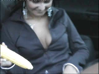 Ear of corn in pierced pussy in car