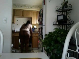 Dark chick does the dishes in panties