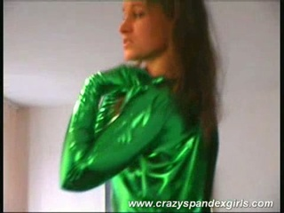 Green spandex catsuit wearing golden-haired disrobes down to  pussy