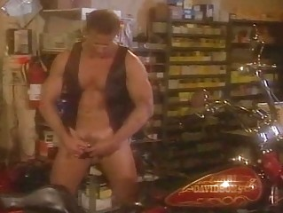 Cute man stroking his dick in the garage
