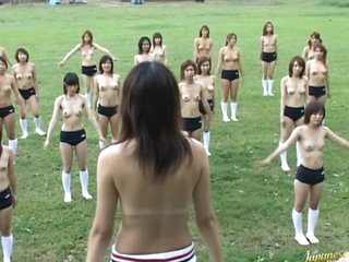Thirty Half-Naked Asian Women Exercising Outdoors