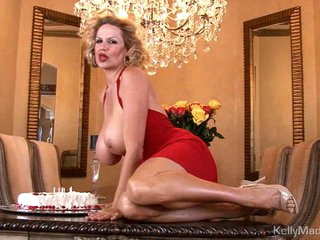 Kelly Madison has fun with her birthday cake on titties