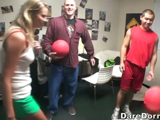 Sweet college blonde and another pretty chick plays dodgeball with dorm guys. That's the way they kill time. And they love it! Watch them play.