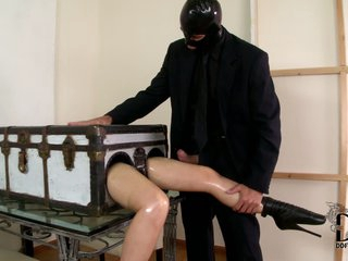 This fetish video is all about long legged lady in a box Latex Lucy getting her pussy fingered by masked man in black. A nice idea for fetish fun isn't it?