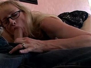 Breasty blond cougar sucks pecker during the time that wearing glasses
