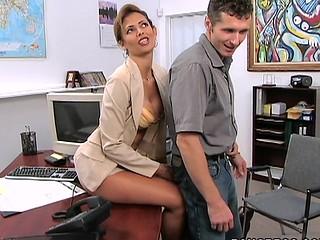 Winning brunette is having sexual intercourse with her boss indoors
