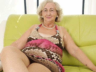 aged grandma playing with a purple sextoy