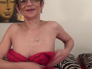 Ripened horny trull is kneeling on the bed to finger her tight anus