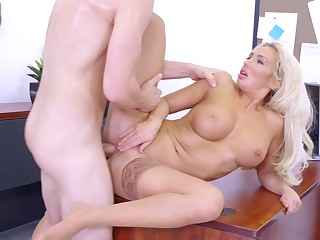 A hot pretty good with large boobs is on the desk, getting fucked