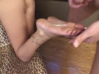 She gives footjob and he cums on her soles