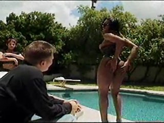 Black tranny eats large cock poolside
