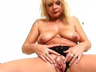 Mature blonde Rosalyn plays with herself in the shower - Trion Media