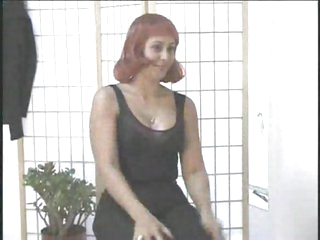 Woman with red wig sucking