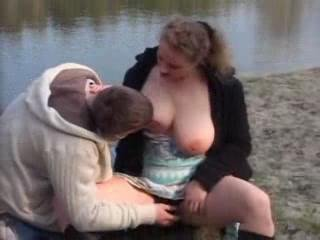 Amateur - Young man and busty  woman outdoor