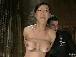 Asian hottie Tia Ling gets her lucious tits and steamy love tunnel teased while tied up