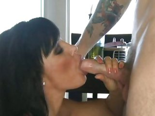 Lisa Ann gets on her knees to mouth a horny jock