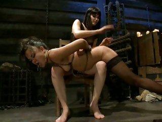 Femdom Bobbi Starr spanks a naughty Annie Cruz