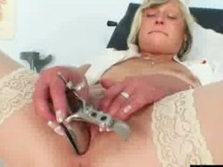 Filthy nurse milf Nada fucks herself with big fake penis