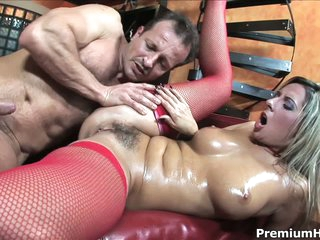 Daria Glower is a sexy as hell european mllf. She wears red mesh stockings in this video. Stacked blond Daria Glower give head and then fellow fucks her hairy pussy like mad.