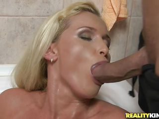 blonde washing her hairy pussy gets a cock in her mouth