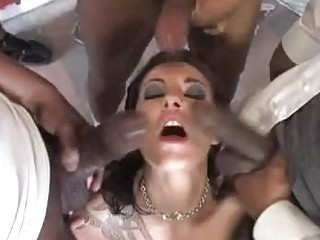 White chocolate babe with tattoo plays with black dicks in gang bang
