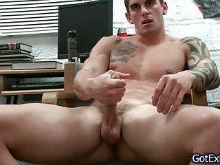 Amazing muscled and tattoed hunk jerking